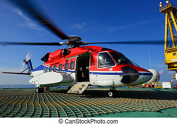 The helicopter park on oil rig to pick up worker - The...
