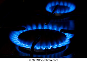 Gas - Ble gas flame of on oven in the dark