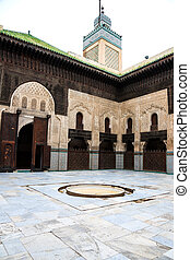 Bou inania madrasa - Courtyard and minaret of bou inania...