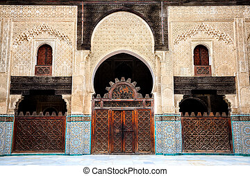 Courtyard of bou inania madrasa - Delicate decoration at the...