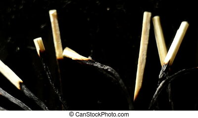 Burnt matches on the ground