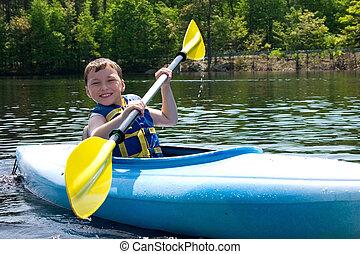 Boy kayaking - Happy boy kayaking