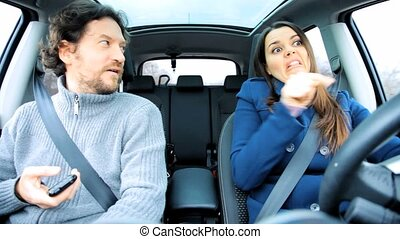 Couple making peace in car