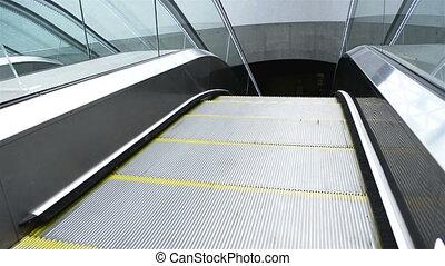 Underground escalator moving down closeup - Underground...