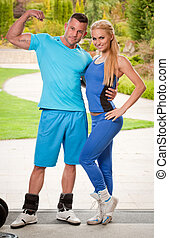 Fit couple. - Outdoors portrait of a very fit attractive...