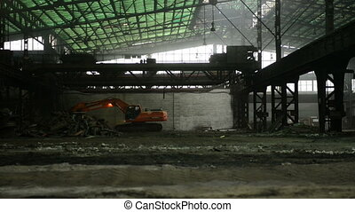 Construction machine inside industrial interior moving