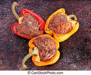 Stuffed peppers on brown background - Stuffed bell peppers...