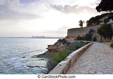 Paved coastal walkway on a summer e