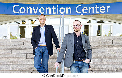 Convention attendees - Two smart casual dressed colleagues,...