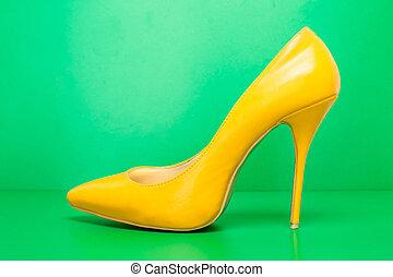 single yellow high heels - singel yellow high heels on green...