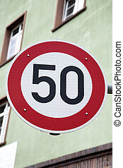 Red Fifty Speed Sign in Urban Setting