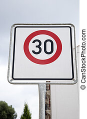 Red Thirty Speed Sign in Urban Setting
