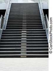 Stairway to the success. - the symetric stairway outside of...