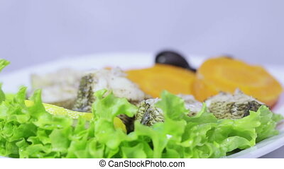 Fish prepared on steamer - On lettuce leaves stacked fish...