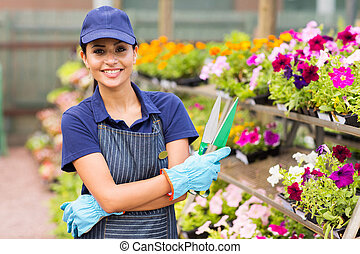 young nursery business owner portrait - beautiful young...