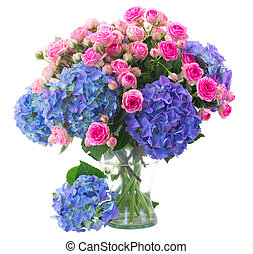 posy of pink roses and blue hortensia flowers close up -...