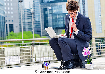 Junior executive dynamic working outside of his office