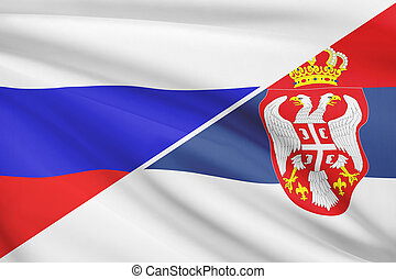 Series of ruffled flags Russia and Republic of Serbia -...