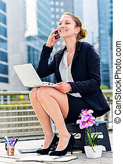 Junior executive dynamic working outside of her office