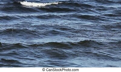Rough Waters - sea waves with foam crests
