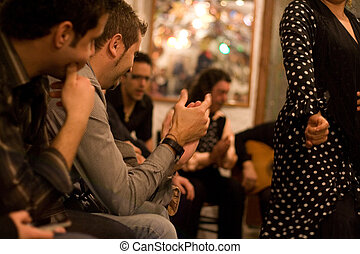 Public claping the dancer woman - Flamenco performance in...