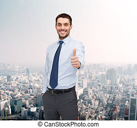 handsome businessman showing thumbs up - business and office...