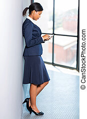 african american career woman using cell phone -...