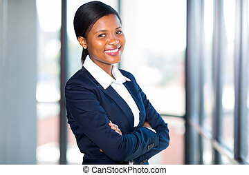 african american businesswoman with arms folded