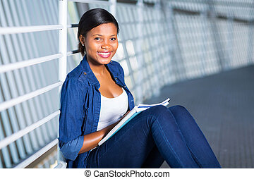 african american college student with books
