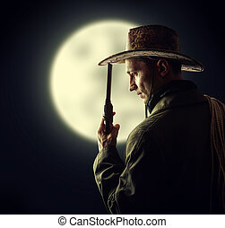 cowboy holding hat and revolver - silhouette of cowboy...