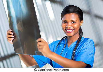 african american healthcare worker with x-ray - beautiful...