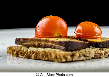 Wholewheat bread with tofu and tomato - Low angle image of...