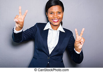 young african woman with peace sign - cheerful young african...