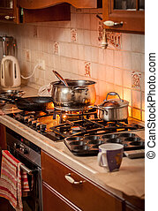 pan boiling on burning gas stove on country style kitchen -...