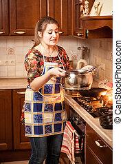 beautiful woman carrying soup in metal saucepan - Portrait...
