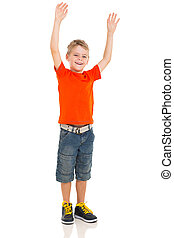 little boy with arms up - excited little boy with arms up on...