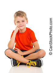 boy sitting on white background - cute little boy sitting on...