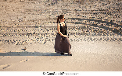 lonely woman standing on sand dune - Outdoor photo of lonely...