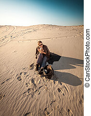 woman with bag lost in desert - Photo of woman with bag lost...