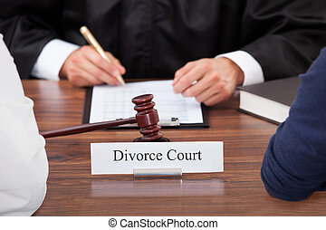 Couple With Judge In Court - Cropped image of couple with...