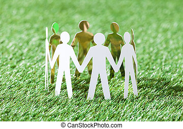 Team Of Paper People On Grassy Field - Team of paper people...