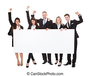 Confident Businesspeople Holding Blank Banner - Full length...