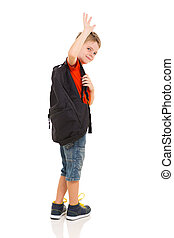 male elementary school student waving goodbye isolated on...