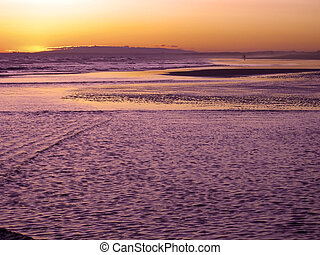 Lonely figure - lonely figure at sunset on the beach of...