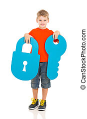 young boy holding paper lock and key - portrait of young boy...