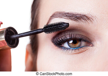 Woman using mascara - Young beautiful woman applying mascara...