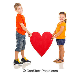 kids holding heart shape - two happy kids holding heart...