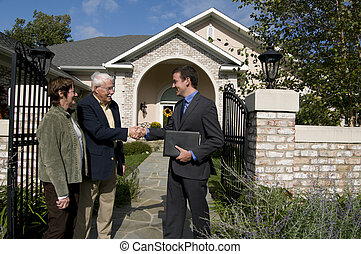 senior couple meeting with realtor - a married couple...