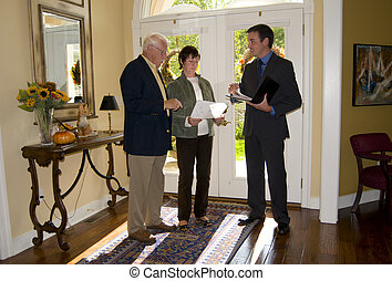 agent showing home to senior couple - real estate agent...