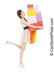 happy young woman holding gift box and shopping bag